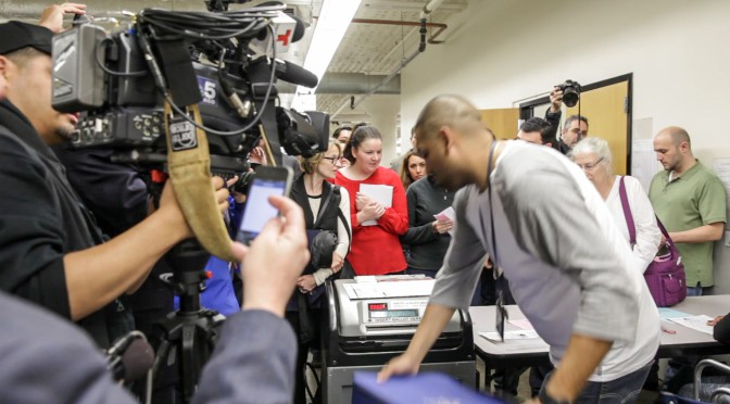 Representatives from the both the Garza and Pope campaigns and media watch as ballots are counted following the April 7 election.  Lizz Giordano/Medill