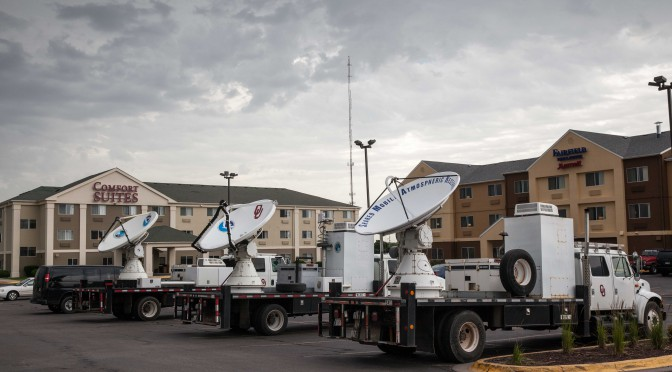 Researchers parked their mobile weather radars from the University of Oklahoma and NOAA in a hotel parking lot in Lincoln, Nebraska. They collected storm data late into the night for the Plains Elevated Convection At Night (PECAN) weather research project.