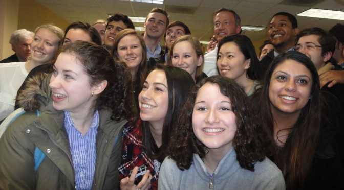 Governor of Maryland Martin O'Malley takes pictures with young supporters at his campaign office in Des Moines on Caucus Day.