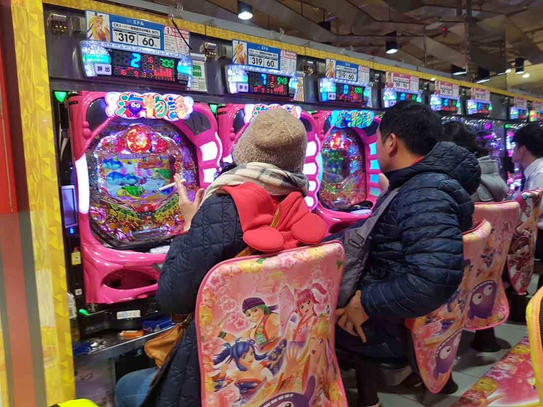 Couple playing pachinko