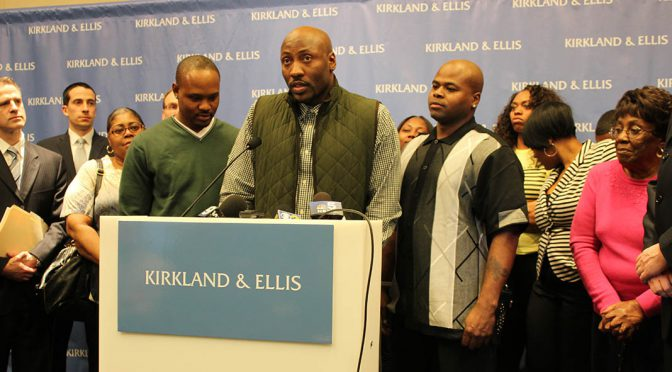 Lashawn Ezell, Larod Styles and Charles Johnson stand with family and legal team to speak about their exoneration Wednesday afternoon. (Kara Voght/MEDILL)