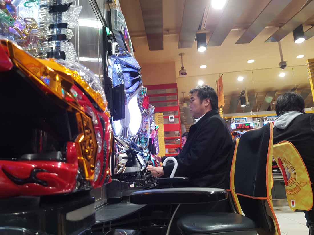 Man playing pachinko