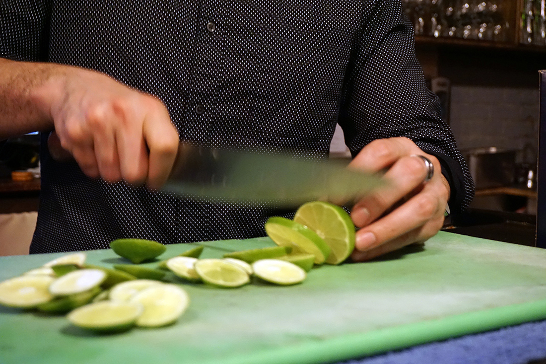 food photos that show what diversity tastes like medill southport and irving s manager ardit dizdari deftly slices up limes for the traditional margaritas the team is preparing for cocktail hour