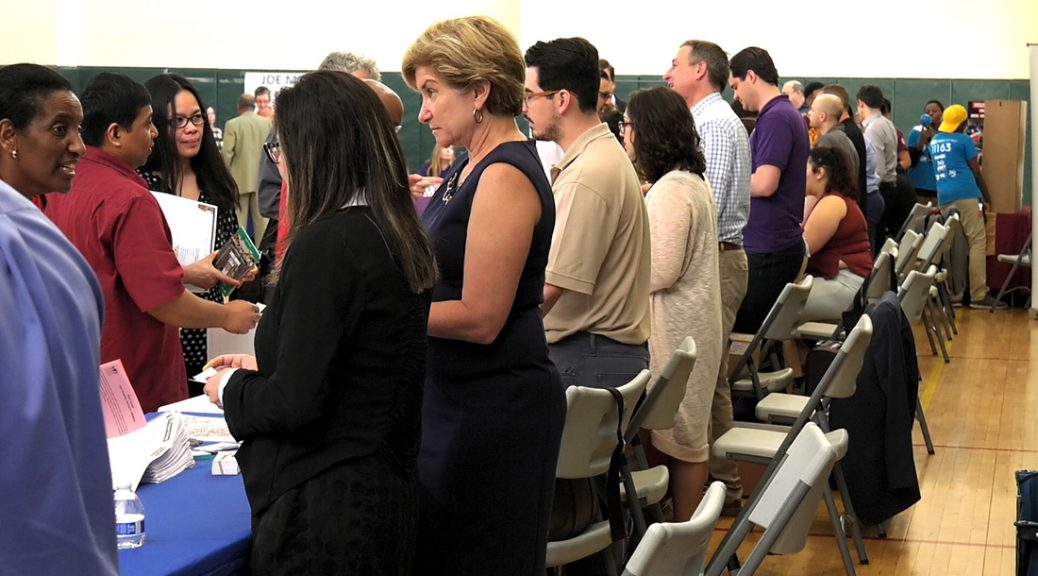 Employers talk to Chicagoans at a rogers Park job fair. Forty companies attended the fair, hosted by the City of Chicago. (Rothman/MEDILL)