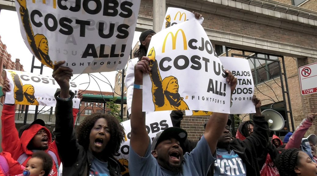 "Protests erupt at the construction site for the new corporate McDonalds headquarters in West Town. Workers chant ""We want fifteen,"" fighting for increased minimum wage. (Rothman/MEDILL)"