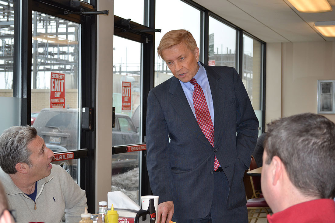 "Bob Fioretti greets people at Manny's Deli where he ordered ""the usual"" -- a ""big"" pastrami sandwich, a potato pancake, matzo ball soup and a carton of milk. (Stephanie Choporis/MEDILL)"