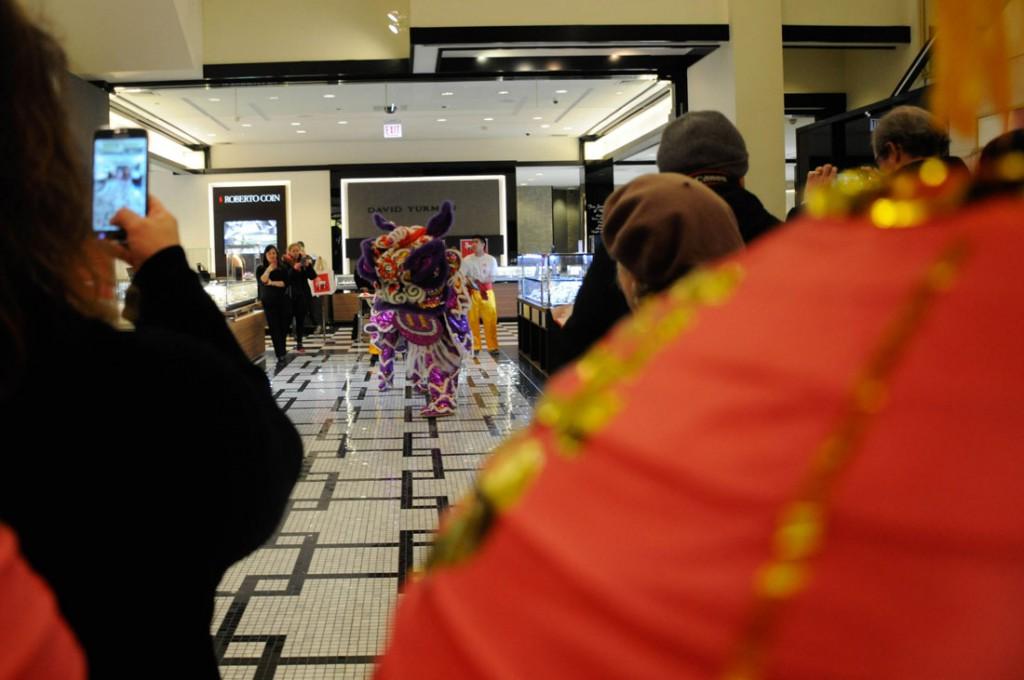 Lion dancers perform around Bloomingdale's.