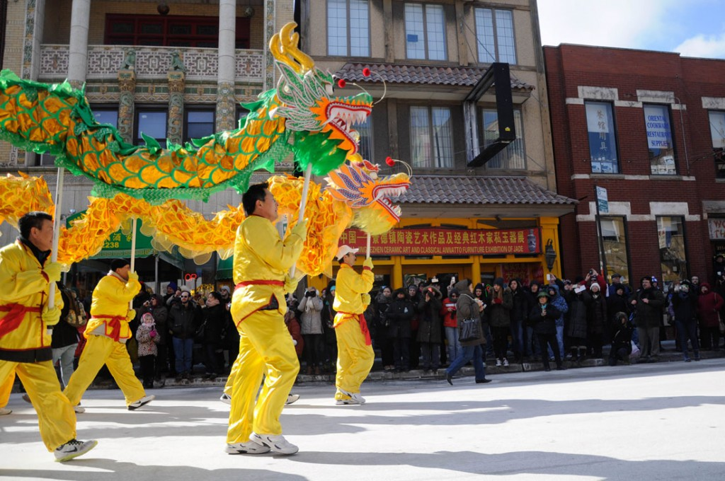 Two dragons march at the Chinese New Year parade in Chinatown