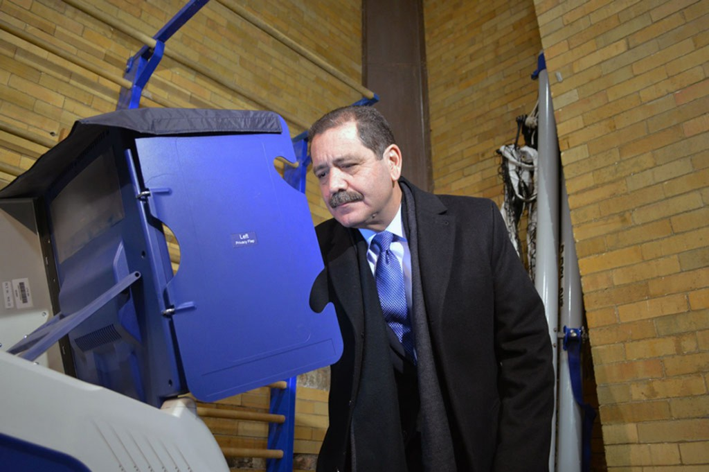 """Mayoral candidate Jesus """"Chuy"""" Garcia votes this morning. His wife Evelyn Garcia joined him at the polls. (Meg Anderson/Medill)"""
