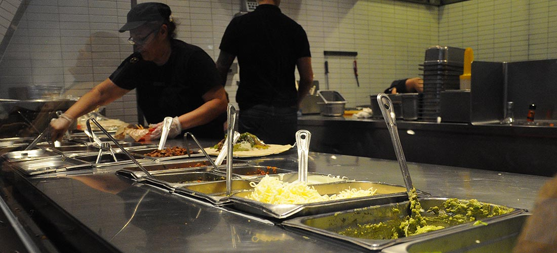 Chipotle behind the counter