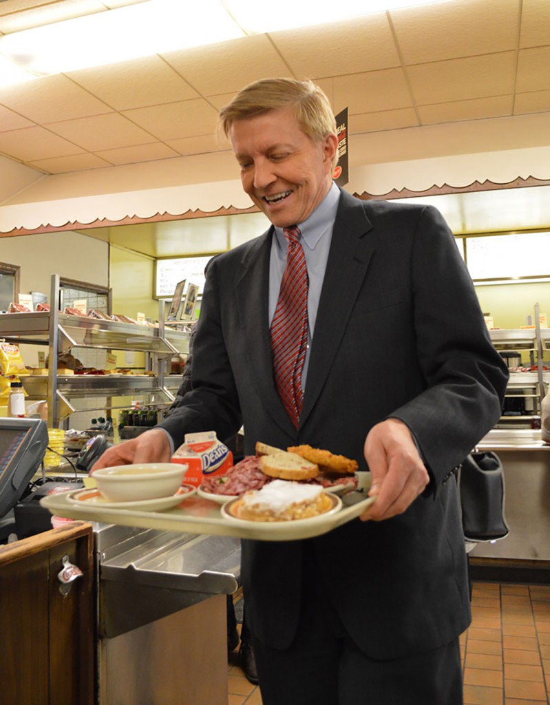 Mayoral candidate Bob Fioretti takes lunch to his table at Manny's Deli, 1141 S. Jefferson. (Meg Anderson/Medill)