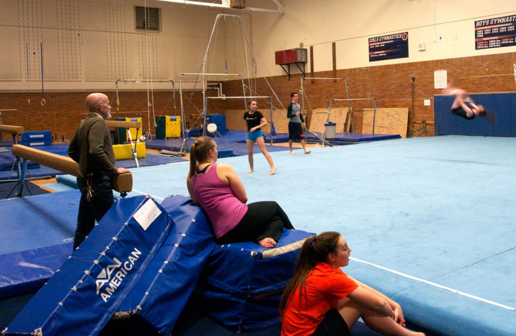 Jones and girls' gymnastics assistant coach Meghan Gordon look on as girls practice floor exercises. (Tim Penman/Medill)