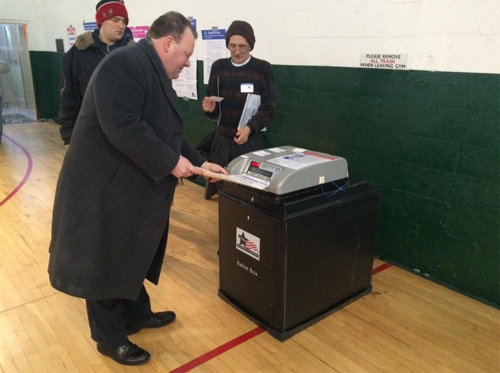 Patrick Daley Thompson, who is running for 11th Ward alderman, votes this morning. (Dean DeChiaro/Medill)