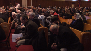 Church-goers pray at a vigil held at Assyrian Church of the East - St. Andrew's Parish