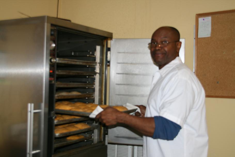 Michael Hume makes Jamaican delicacies at his Caribbean American Bakery.  (Yinmeng Liu/Medill)