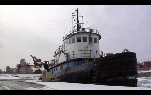 A tug boat sits in the dock in the Calumet Harbor.