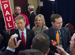 Kentucky Sen. Rand Paul speaks to press following the Fox Business GOP prime-time debate Tuesday. Paul differed from the other seven candidates mainly in his desire to cut military spending excesses rather than expand military spending.