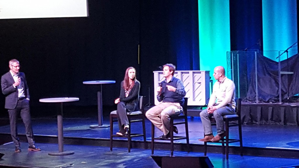 Stephen Bauman (left), president and CEO of World Relief, leads a panel about Christian responses to the refugee crisis on Wednesday at the GC2 summit in Naperville. (Jay Bouchard/MEDILL)
