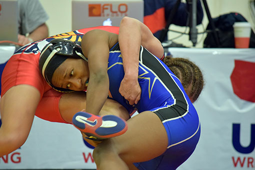 Erin Golston takes down Breonah Neal in the second round at the Dave Schultz Memorial International tournament. (Jasmine Cannon/MEDILL)