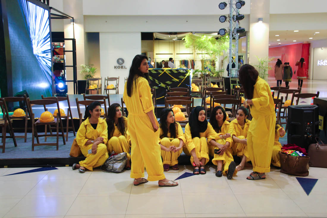 Textile students from Indus Valley College wait to be ushers for the CAT Apparel fashion show, Jan. 29, 2016 (Kat Lonsdorf/MEDILL)