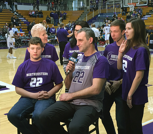 The Olah and Smith families prepare for an interview on Big Ten Network before Sunday's game against Nebraska. (Adam Rossow/MEDILL)