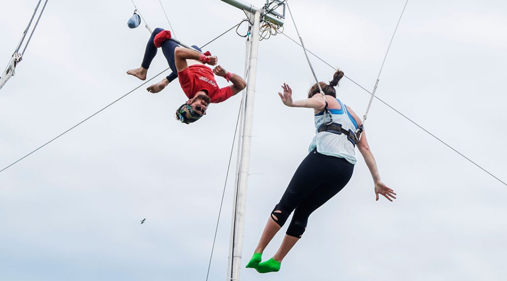 Instructor and student on trapeze