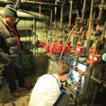 Workers inspect boilers