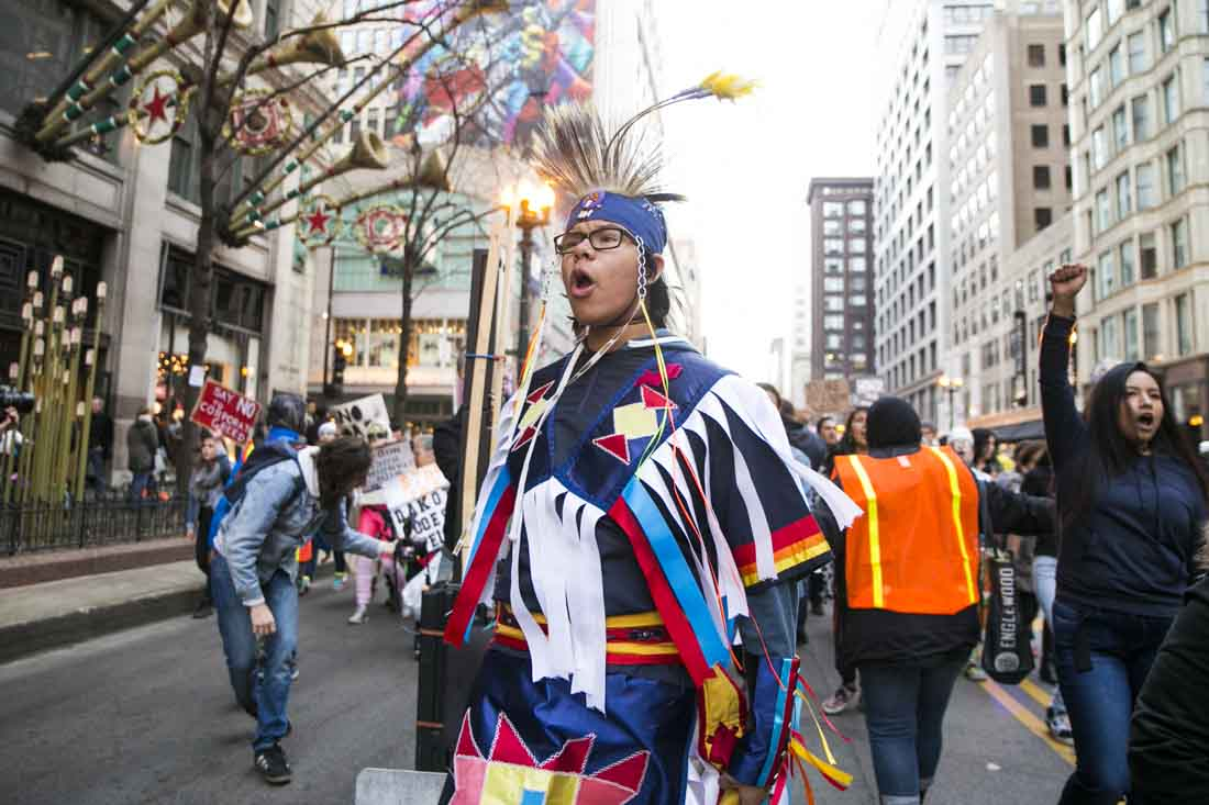 Young Native American leading rally