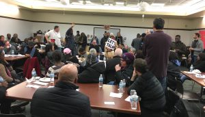 Activists and Mount Greenwood residents gather at local library to discuss tensions surrounding the shooting death of Joshua Beal by an off-duty police officer.