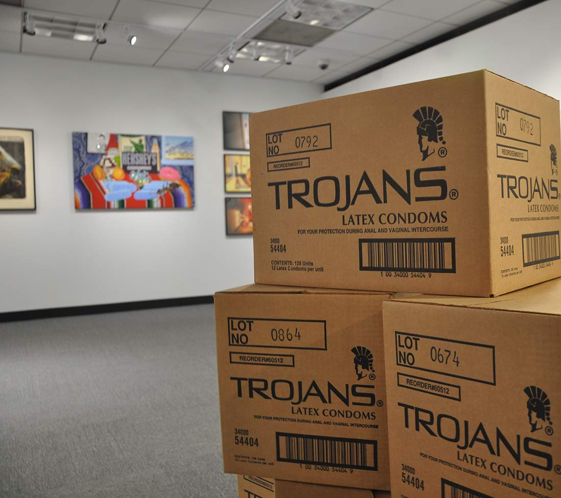 An art installation of cardboard boxes of trojan condoms