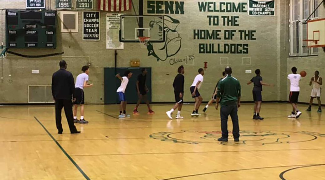 Senn boys' basketball coach Terrell Walsh and assistant Marcus Riley