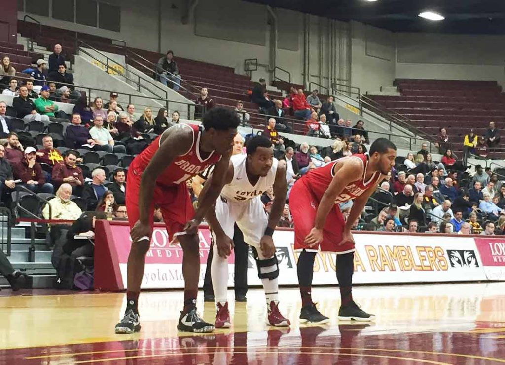 Loyola guard Tyson Smith, middle, waits for a free throw in a game against Bradley on Jan. 25.