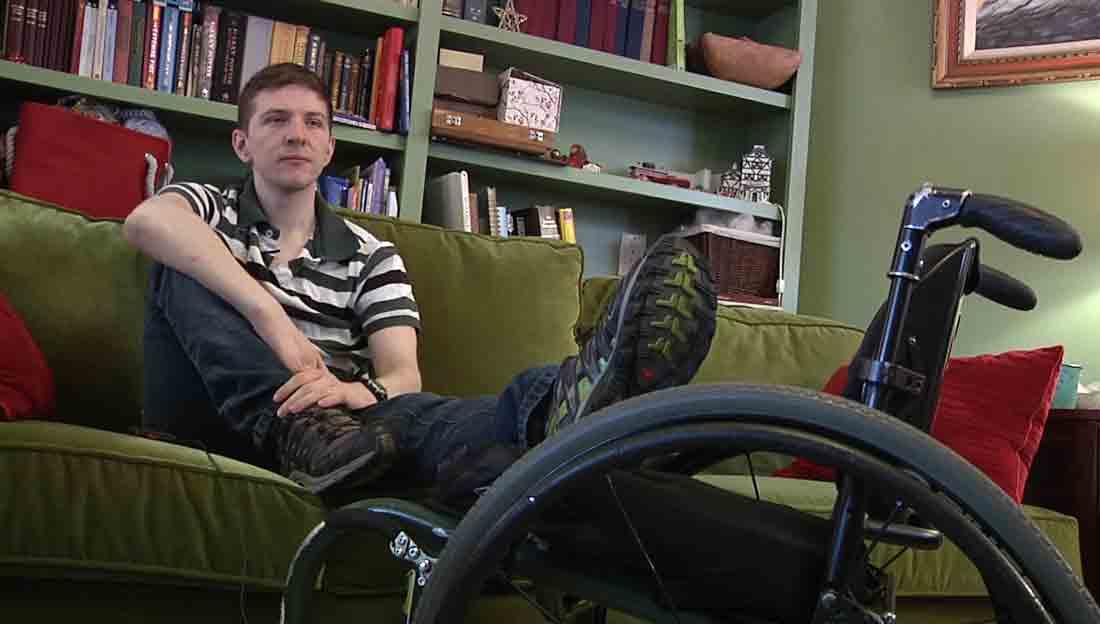 Peter Vishneski sits in the living room of his family's home in Oak Park.