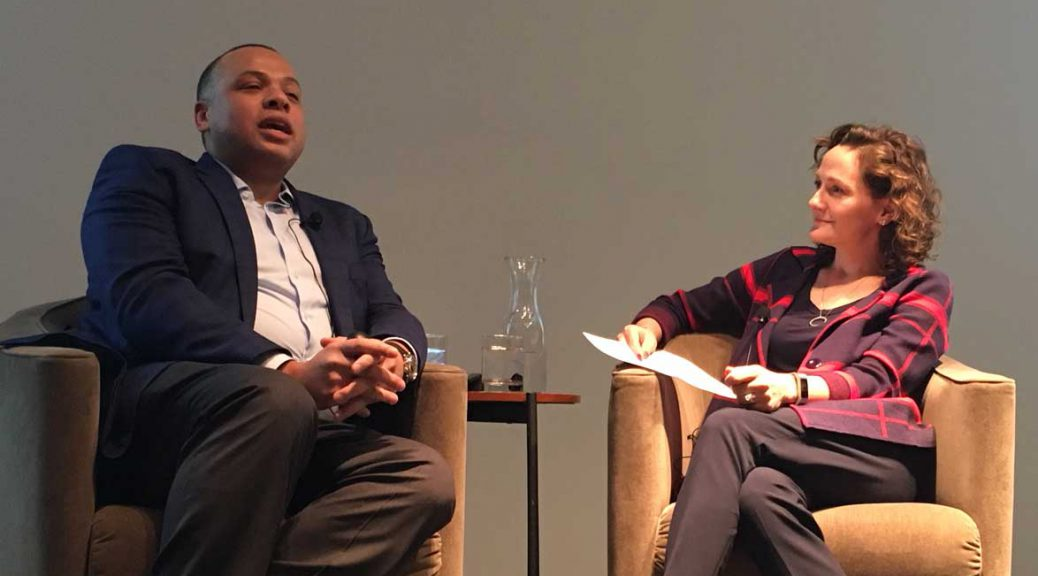 Chicago City Treasurer Kurt Summers speaks with Christina Hachikian of the Rustandy Center at the Gleacher Center. Jan. 17, 2018. (Brian Baker/MEDILL)