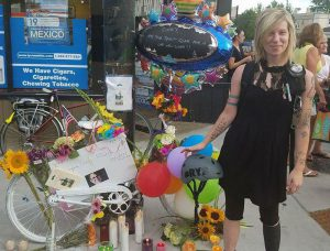 Green stands by a ghost bike memorial.