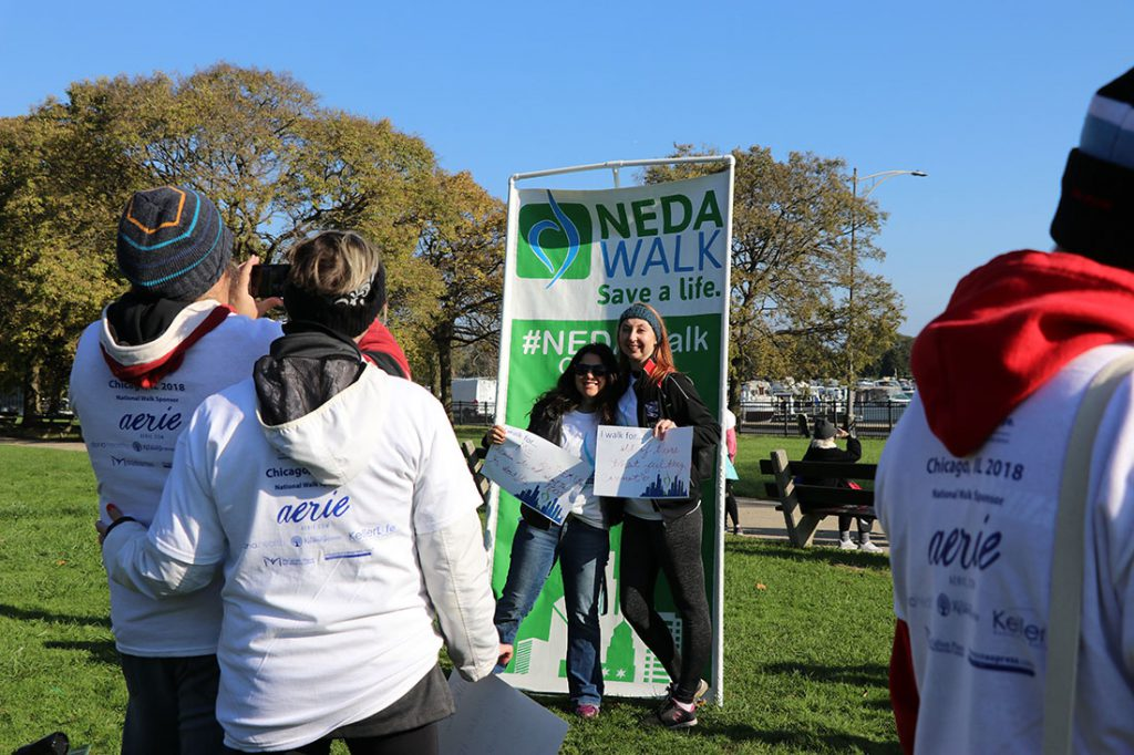 People pose for a picture at the NEDA walk.