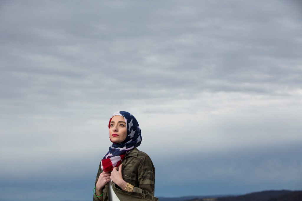 Photograph of Berzingi wearing an American flag head scarf, taken by Nancy Andrews for her series '100 Days, 100 Voices'. (Nancy Andrews/100 Days in Appalachia)