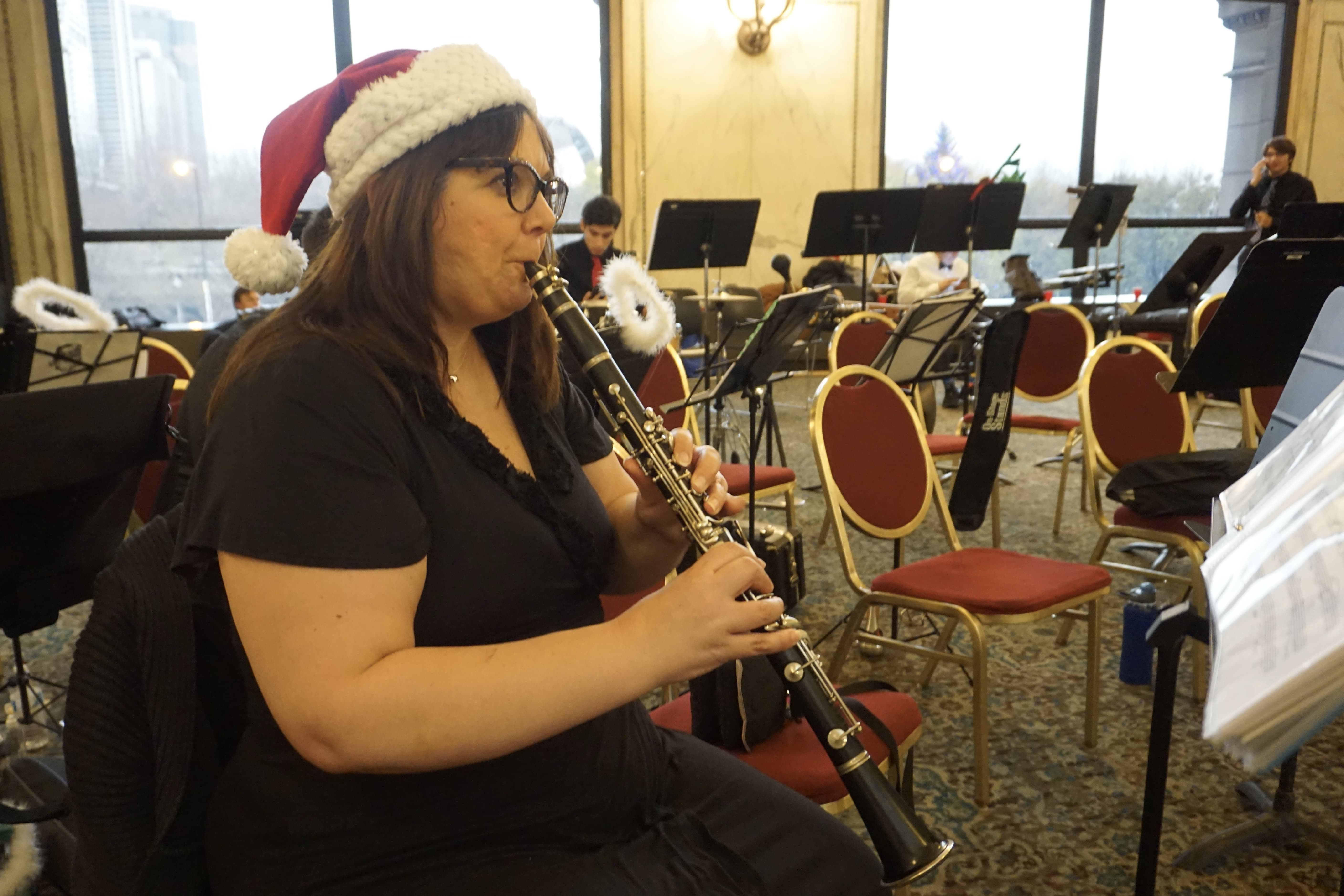 """""""Music helped me to come out of my shell when I was younger,"""" said Vahona Richardson, a volunteer clarinet player since May. She said music showed her that she had a unique talent, and taught her to work hard toward a goal. (Xiaoyi Liu/MEDILL)"""