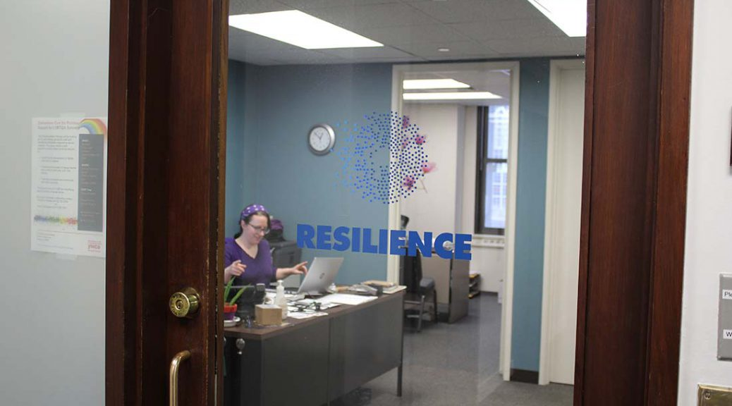 The door to Resilience offices, showing the organization's logo.