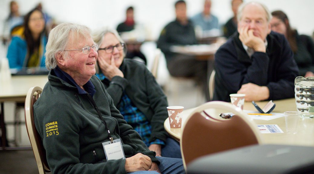 Wally Broecker, left, sits with his wife Elizabeth, center, while listening to a research presentation at the 2015 Comer Climate Conference. (Jasmin Shah/Comer Family Foundation)